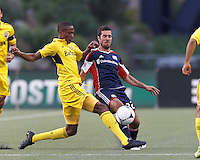 Columbus Crew midfielder Kevan George (37) disrupts New England Revolution forward Benny Feilhaber (22) pass. In a Major League Soccer (MLS) match, the New England Revolution tied the Columbus Crew, 0-0, at Gillette Stadium on June 16, 2012.