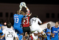 Troy Perkins (23) grabs the ball above Cornell Glen (13) and teammates Andy Najar (14). The San Jose Earthquakes tied DC United 1-1 at Buck Shaw Stadium in Santa Clara, California on July 3rd, 2010.
