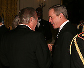 United States Secretary of Defense Donald Rumsfeld and US President  George W. Bush talk before the entertainment at a White House State Dinner for the nation's governors in Washington, DC on February 26, 2006. <br /> Credit: Dennis Brack / Pool via CNP