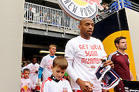 Thierry Henry (14) of the New York Red Bulls and Drew Moor (3) of the Colorado Rapids enter the field. The New York Red Bulls defeated the Colorado Rapids 4-1 during a Major League Soccer (MLS) match at Red Bull Arena in Harrison, NJ, on March 25, 2012.