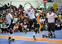 15 MAR 2014 - BIRMINGHAM, GBR - Team England jammer Reaper (second from the left) jumps past Wizards of Aus blocker Justin Credible during the bout between the two teams at the inaugural Men's Roller Derby World Cup in the Futsal Arena in Birmingham, West Midlands, Great Britain (PHOTO COPYRIGHT © 2014 NIGEL FARROW, ALL RIGHTS RESERVED)