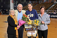 25 February 2012:  FIU honors senior guard Fanni Hutlassa (10), pictured with her grandparents and Head Coach Cindy Russo, in a ceremony prior to the start of the game.  The FIU Golden Panthers defeated the University of South Alabama Jaguars, 58-55 (OT), at the U.S. Century Bank Arena in Miami, Florida.