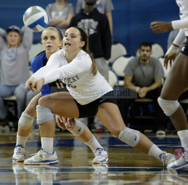Sophomore Jackie Napper and senior Stephanie Klefot (11) save a spiked ball during the UK women's volleyball game v. Ohio University during the second round of the NCAA tournament in Memorial Coliseum in Lexington, Ky., on Saturday, December 1, 2012. Photo by Genevieve Adams | Staff