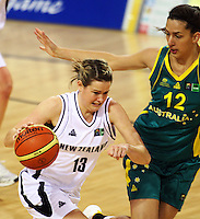 Tall Ferns forward Georgina Richards drives past centre Mariana Tolo during the International women's basketball match between NZ Tall Ferns and Australian Opals at Te Rauparaha Stadium, Porirua, Wellington, New Zealand on Monday 31 August 2009. Photo: Dave Lintott / lintottphoto.co.nz