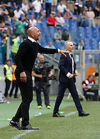Calcio, Serie A: Lazio vs Roma. Roma, stadio Olimpico, 3 aprile 2016.<br /> Roma's coach Luciano Spalletti, left, and Lazio coach Stefano Pioli follow the game during the Italian Serie A football match between Lazio and Roma at Rome's Olympic stadium, 3 April 2016.<br /> UPDATE IMAGES PRESS/Isabella Bonotto