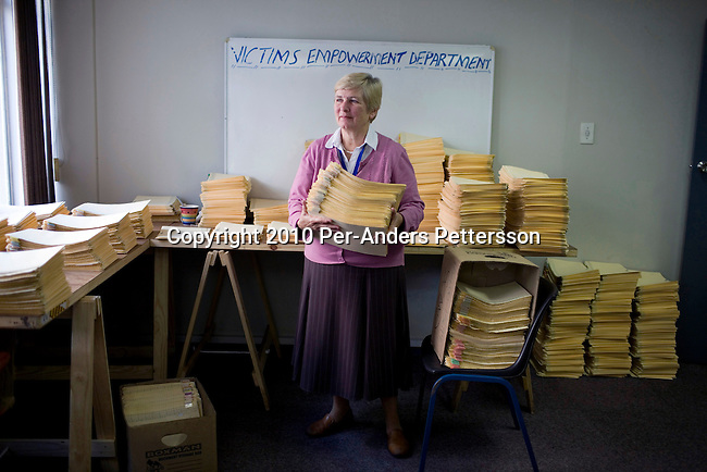 JOHANNESBURG, SOUTH AFRICA - APRIL 13: Majorie Jobson, a commissioner, at Khulumani support group, holds case files for victims of Apartheid in their offices on April 13, 2010, in central Johannesburg, South Africa. Khulumani is involved among other things in a lawsuit  against Daimler AG, with complaints brought forward by victims of Apartheid. The plaintiffs argue that Daimler sold vehicles to the old South African government, and they were used by the police and security forces to keep up the Apartheid regime. (Photo by Per-Anders Pettersson/Getty Images)