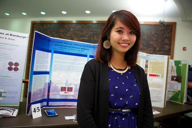 Benlina Aier, a psychology major, researched animal behavior at Lincoln Park Zoo. She observed species including polar bears and African lions, to look for clues about animal welfare. DePaul University students presented posters of their own research at the College of Science and Health's 12th Annual Natural Science Mathematics and Technology Undergraduate Research Showcase November 7th, 2014 in the McGowan South science building on the Lincoln Park campus. (DePaul University/Jeff Carrion)