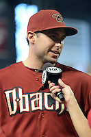 Arizona Diamondbacks first baseman Paul Goldschmidt (44) gives a post game interview after a game against the Washington Nationals at Chase Field on September 29, 2013 in Phoenix, Arizona.  Arizona defeated Washington 3-2.  (Mike Janes/Four Seam Images)