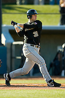 Joey Henshaw #31 of the Army Black Knights follows through on his swing at the UNCG Baseball Stadium March 5, 2010, in Greensboro, NC.  Photo by Brian Westerholt / Four Seam Images