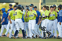 Brian Sharp (7) of the Columbia Fireflies is congratulated by his teammates after his walk-off hit against the Rome Braves in the bottom of the 7th inning at Segra Park on May 13, 2019 in Columbia, South Carolina. The Fireflies walked-off the Braves 2-1 in game one of a doubleheader. (Brian Westerholt/Four Seam Images)