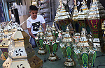 """A picture taken on May 16, 2018 shows A Palestinian boy displays a traditional lantern known in Arabic as """"Fanous"""" at a market during the holy month of Ramadan, in the West Bank city of Nablus. Ramadan is sacred to Muslims because it is during that month that tradition says the Koran was revealed to the Prophet Mohammed. The fast is one of the five main religious obligations under Islam. Muslims around the world will mark the month, during which believers abstain from eating, drinking, smoking and having sex from dawn until sunset. Photo by Ayman Ameen"""