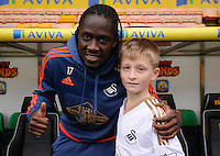 Eder of Swansea City poses with the Matchday Mascot during the Barclays Premier League match between Norwich City and Swansea City played at Carrow Road, Norwich on November 6th 2015