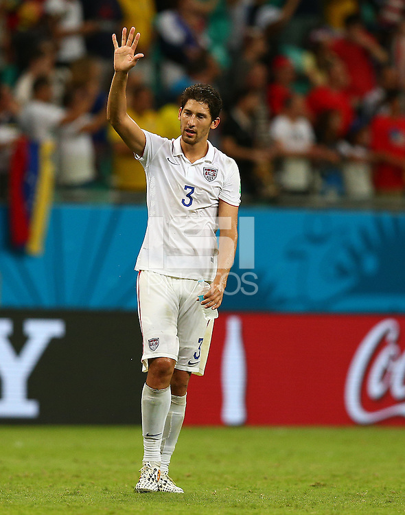 A dejected Omar Gonzalez of USA waves to the fans after being eliminated from the World Cup
