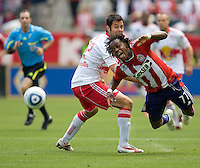 Chivas USA forward Chukwudi Chijindu (77) attempts to move around New York Red Bulls defender Mike Petke (12). Chivas USA defeated the Red Bulls of New York 2-0 at Home Depot Center stadium in Carson, California April 10, 2010.  .