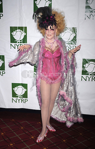 Bette Midler at the 14th annual New York Restoration Project's Hulaween event at the Waldorf-Astoria in New York City. October 30, 2009.. Credit: Dennis Van Tine/MediaPunch