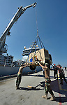 The main harbor of Haiti's capital of Port-au-Prince was devastated by the country's January 12 earthquake, complicating the daunting task of getting international assistance to the hundreds of thousands survivors who are homeless. Yet the main wharf partially reopened on January 23. Here cargo is unloaded from a Royal Dutch Navy ship by U.S. sailors.