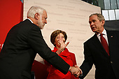 United States President George W. Bush, right, makes remarks at the reopening of the National Museum of American History in Washington, DC on November 19, 2008. After the ceremony five people were sworn in as new citizens of the United States.  First lady Laura Bush, center, attended with the President. <br /> Credit: Gary Fabiano / Pool via CNP