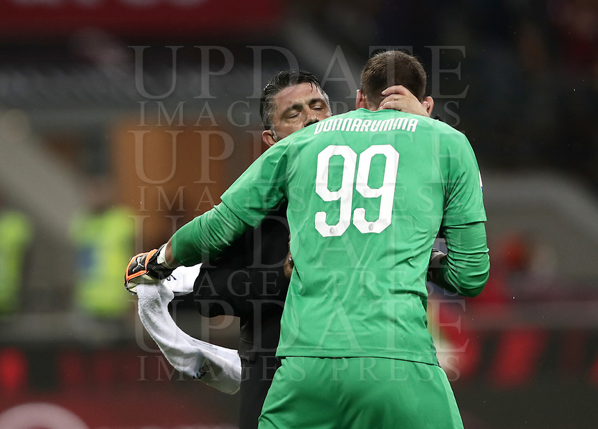 Calcio, Serie A: AC Milan - AS Roma, Milano stadio Giuseppe Meazza (San Siro) 31 agosto 2018. <br /> AC Milan's coach Gennaro Gattuso (l) celebrates with his goalkeeper Gianluigi Donnarumma (r) after winning 2-1 the Italian Serie A football match between Milan and Roma at Giuseppe Meazza stadium, August 31, 2018. <br /> UPDATE IMAGES PRESS/Isabella Bonotto