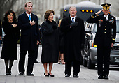 From right, former President George W. Bush, second from right, former first lady Laura Bush, Neil Bush and Sharon Bush, stand as the flag-draped casket of former President George H.W. Bush is carried by a joint services military honor guard from the U.S. Capitol, Wednesday, Dec. 5, 2018, in Washington. <br /> Credit: Alex Brandon / Pool via CNP