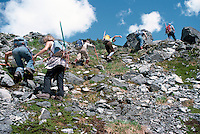 Hikers climbing up Mountain in Manatee Mountains, near Pemberton, BC, British Columbia, Canada, Summer