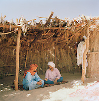 Tuareg tribesmen talking in a desert village, Libya