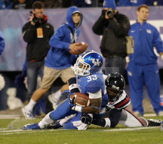 Kentucky Wildcats running back Dyshawn Mobley (33) gets tackled during the second half of the UK Football game v. Samford at Commonwealth Stadium in Lexington, Ky., on Saturday, November 17, 2012. Photo by Genevieve Adams | Staff