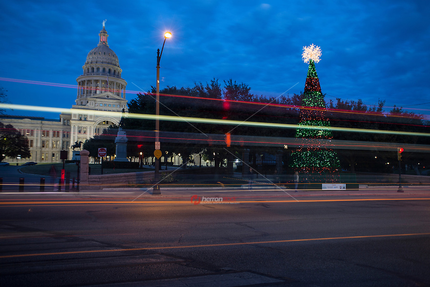 Capitol Christmas Tree in Austin, Texas as car light trails streak by.