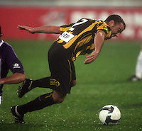 Phoenix' Manny Muscat tries to keep his footing during the A-League football match between Wellington Phoenix and Perth Glory at Westpac Stadium, Wellington, New Zealand on Sunday, 16 August 2009. Photo: Dave Lintott / lintottphoto.co.nz