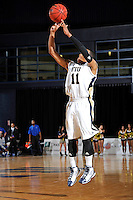 12 January 2012:  FIU guard Phil Taylor (11) puts up a jump shot in the second half as the Middle Tennessee State University Blue Raiders defeated the FIU Golden Panthers, 70-59, at the U.S. Century Bank Arena in Miami, Florida.