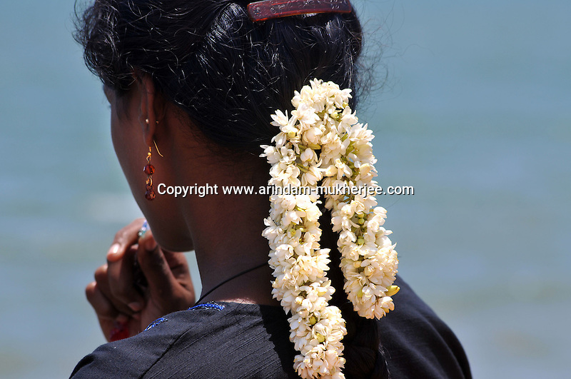 A South Indian woman decorates her hair with flowers, which is very much common  in Pondicherry as well. Arindam Mukherjee/Sipa