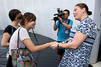 Pavilion Director Annikka Alanko (right) congratulates Finland's Pavilion's 4 millionth visitor Liu Xin (left), in Finnish Pavilion 'Kirnu' on Shanghai World Expo 2010 site, in Shanghai, China, on September 19, 2010. Photo by Lucas Schifres/Pictobank