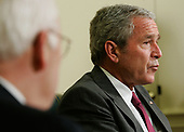 Washington, D.C. - June 14, 2007 -- United States President George W. Bush (R) speaks to the media as he meets with Army Lieutenant General Martin E. Dempsey, former Commanding General of Multi-National Security and Transition Command Iraq, as Vice President Dick Cheney (L) looks on in the Oval Office of the White House  on Thursday, June 14, 2007 in Washington, DC. Army Lieutenant General James Dubik has succeeded Dempsey to take over the command on June 10, 2007 in Baghdad. <br /> Credit: Alex Wong - Pool via CNP