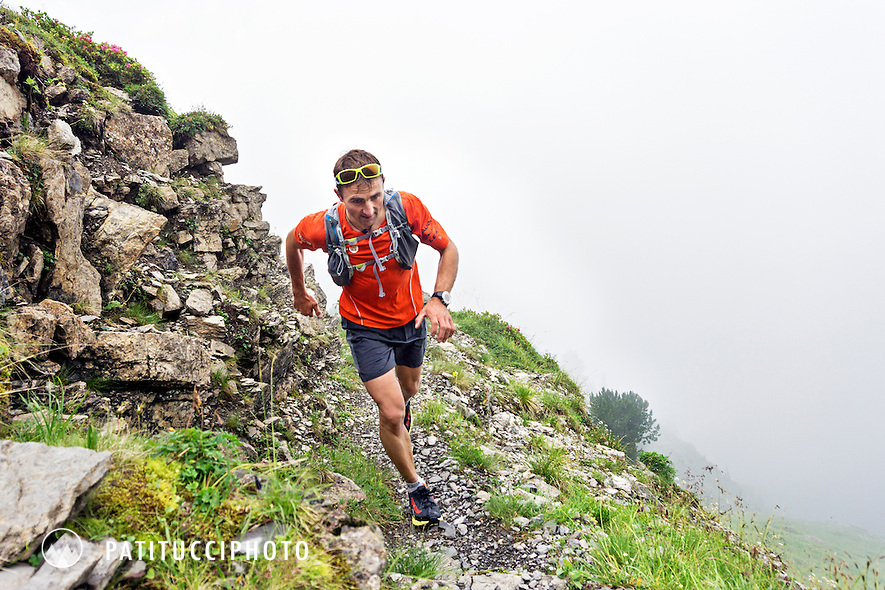 Ueli Steck trail running from Interlaken to First, near Grindelwald, on a cloudy, rainy summer day