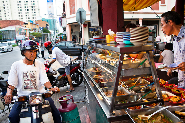 An old man stops to buy lunch at a kopitiam in capital Georgetown of Penang in Malaysia, India. Photo: Sanjit Das/Panos