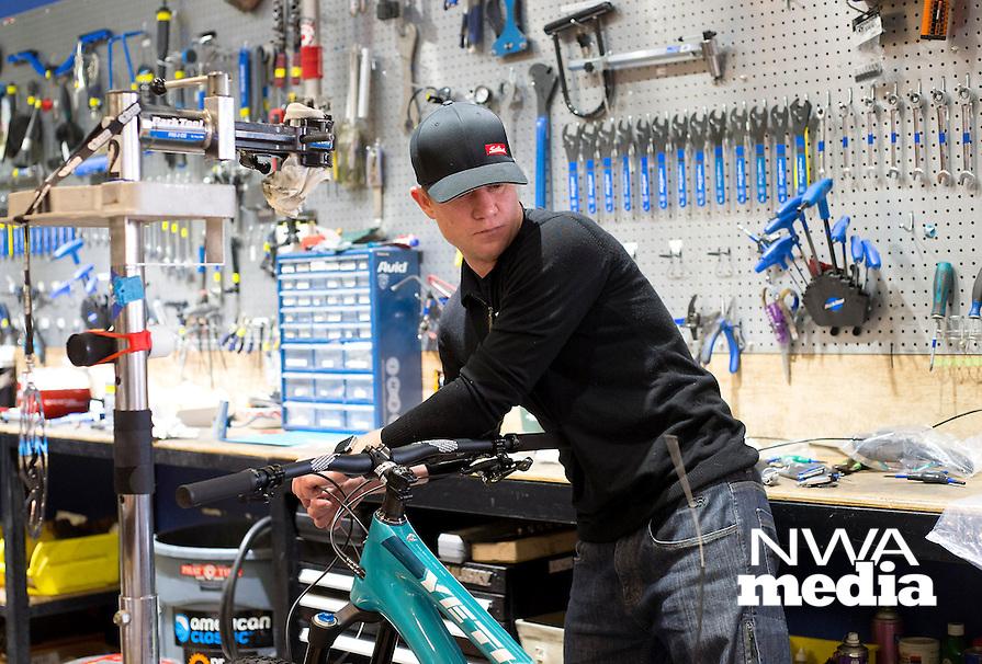 NWA Democrat-Gazette/JASON IVESTER<br /> Bill Ball works on a bicyle on Wednesday, Feb. 8, 2017, at Phat Tire Bike Shop in Bentonville.