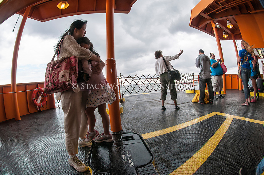 Staten Island, NY - 23 Aug 2014 - Woman taking a selfie on the Staten Island Ferry