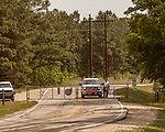 May 5, 2018. Fayetteville, North Carolina.<br /> <br /> Security guards man the gate of the Chemours plant. <br /> <br /> The Chemours Company, a spin off from DuPont, manufactures many chemicals at its plant in Fayetteville, NC. One of these, commonly referred to as GenX, is part of the process of teflon manufacturing. Chemours has been accused of dumping large quantities of GenX into the Cape Fear River and polluting the water supply of city's down river and allowing GenX to leak into local aquifers.