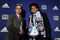 Colorado Rapids second round pick Andre Akpan (Harvard University) and Colorado Rapids VP Jeff Plush (L) during the MLS SuperDraft at the Pennsylvania Convention Center in Philadelphia, PA, on January 14, 2010.