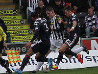 Jason Naismith being closed down by Benjamin Gordon and Graham Carey in the St Mirren v Ross County Scottish Professional Football League Premiership match played at St Mirren Park, Paisley on 3.5.14.