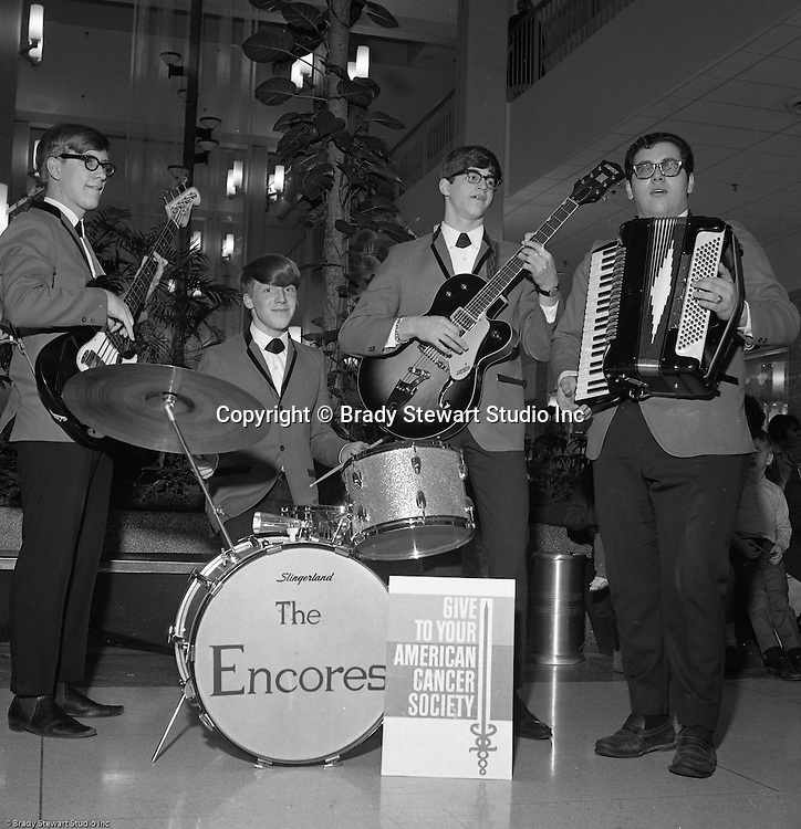 Pittsburgh PA: The Encores band performing at the American Cancer Society Benefit at the new Allegheny Center Mall on the North Side of Pittsburgh - 1966.  The Daniell Sapp and Boorn agency put on the event to benefit the American Cancer Society and the new Allegheny Center Mall.  The mall recently opened and extra publicity is always a good thing.  Daniell Sapp and Boorn which opened in 1962, was active in helping good causes which indirectly promoted their insurance services. During the 1950's and 1960's local corporations and companies were very active in supporting non-profit and charitable organizations.