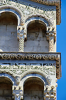 13th century Romaesque arcade pillars, sculptures and inlaid depictions of animals of the Cattedrale di San Martino,  Duomo of Lucca, Tunscany, Italy,