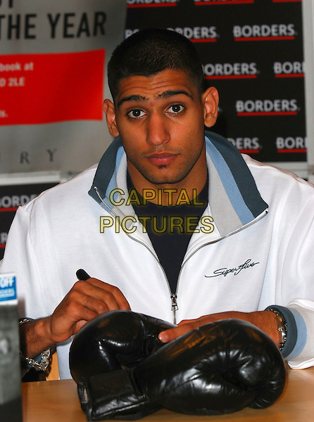 "AMIR KHAN.Attends a signing for his new book entitled ""A Boy From Bolton"" at Borders Books, 203 Oxford Street, London, England, October 21st 2006..half length  autographing gloves olympic boxing champion boxer.Ref: CAN.www.capitalpictures.com.sales@capitalpictures.com.©Can Nguyen/Capital Pictures"