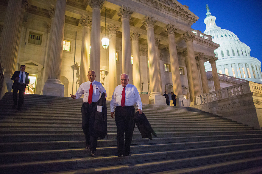 Members of the House of Representatives leave the Capitol after a procedural vote on the impending shutdown of the government set to commence in a few hours.