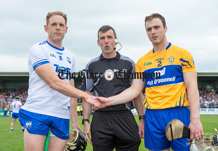 Captains Kevin Moran of Waterford and Patrick O Connor of Clare with referee Paud O Dwyer  before their Munster  championship round robin game at Cusack Park Photograph by John Kelly.