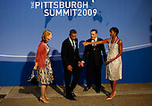 Pittsburgh, PA - September 24, 2009 -- United States President Barack Obama (2L) and U.S. first lady Michelle Obama (R) welcome British Prime Minister Gordon Brown (2R) and his wife Sarah Brown to the welcoming dinner for G-20 leaders at the Phipps Conservatory on September 24, 2009 in Pittsburgh, Pennsylvania. Heads of state from the world's leading economic powers arrived today for the two-day G-20 summit held at the David L. Lawrence Convention Center aimed at promoting economic growth..Credit: Win McNamee / Pool via CNP