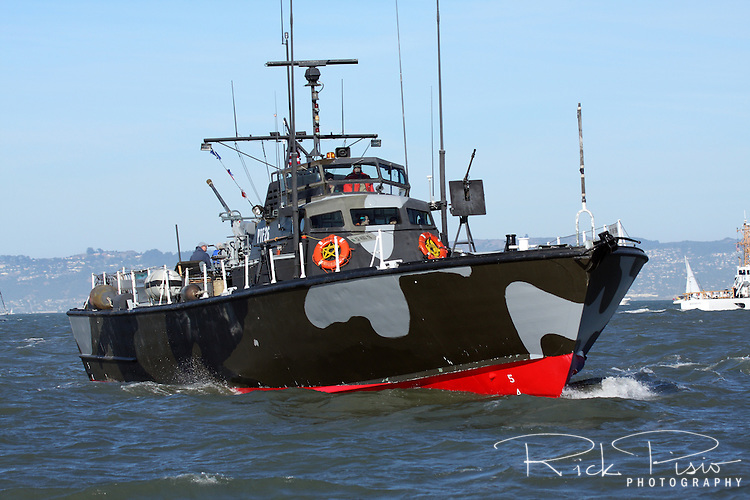 PTF-26 on San Francisco Bay during Fleet Week, 2010. PTFs were the Vietnam War version of the famous WW II PT Boats. They were heavily armed, near-coastal gunboats, used mostly by Special Forces. With a crew of 19 manning a 40mm Bofors cannon aft, two 20mm Oerlikon AA guns just forward of the house and a .50 caliber Browning machine gun/81mm mortar piggy-back mount forward, her design speed was 40 knots. PTF-26 is the last of only four Osprey-Class PTFs, the bigger, aluminum-hulled sister to the wooden Nasty-Class boats. PTF-26 is the final PTF and the last US PT Boat ever built. PTF-26 is operated by the Liberty Maritime Museum in Sacramento, California.