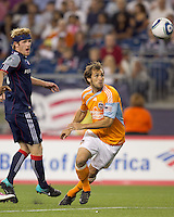 Houston Dynamo midfielder Brian Mullan (9) pivots towards the ball. The New England Revolution defeated Houston Dynamo, 1-0, at Gillette Stadium on August 14, 2010.
