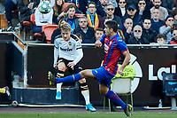 4th January 2020; Mestalla, Valencia, Spain; La Liga Football,Valencia versus Eibar; Daniel Wass of Valencia CF centers the ball challenged by Sergio Alvarez of Eibar - Editorial Use