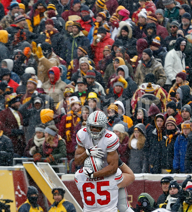Ohio State Buckeyes wide receiver Evan Spencer (6) jumps into the arms of Ohio State Buckeyes offensive lineman Pat Elflein (65) after a touchdown catch during the 4th quarter at TCF Bank Stadium in Minneapolis, Minn. on November 15, 2014.  (Dispatch photo by Kyle Robertson)