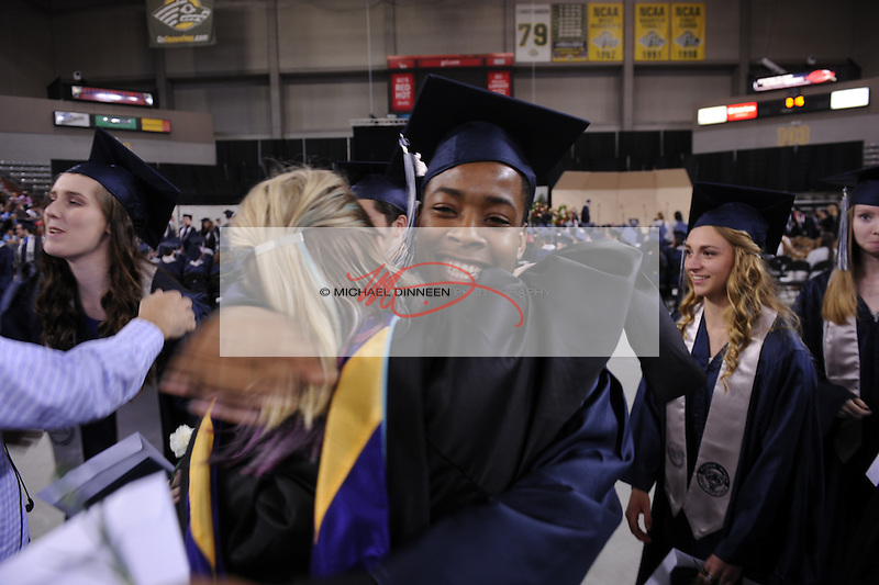 Abbel Frage hugs English teacher Melissa Casey at the Eagle River High School commencement Monday May 9, 2016.  Photo for the Star by Michael DInneen